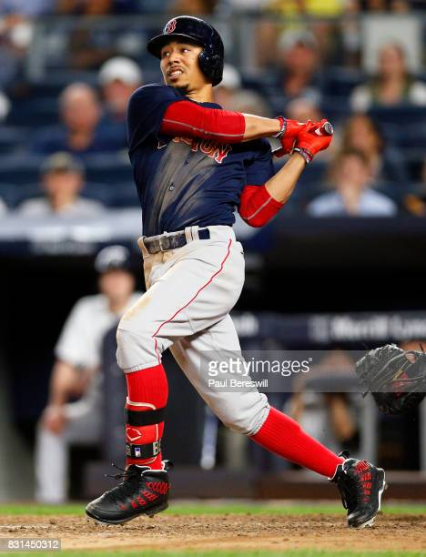 Mookie Betts of the Boston Red Sox bats in an MLB baseball game against the New York Yankees on August 11 2017 at Yankee Stadium in the Bronx borough...