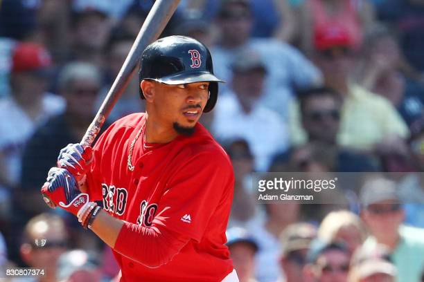 Mookie Betts of the Boston Red Sox bats in the seventh inning of game one of a doubelheader against the New York Yankees at Fenway Park on July 16...