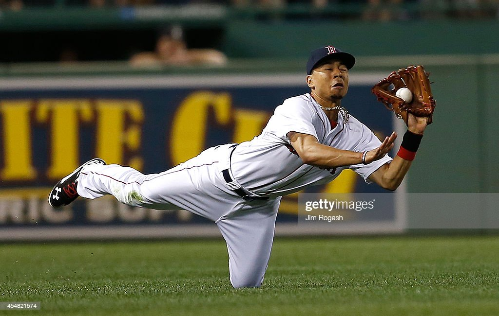 <a gi-track='captionPersonalityLinkClicked' href=/galleries/search?phrase=Mookie+Betts&family=editorial&specificpeople=12732023 ng-click='$event.stopPropagation()'>Mookie Betts</a> #50 of the Boston Red Sox catches a ball hit by Kevin Pillar #11 of the Toronto Blue Jays in the eighth inning at Fenway Park on September 6, 2014 in Boston, Massachusetts.