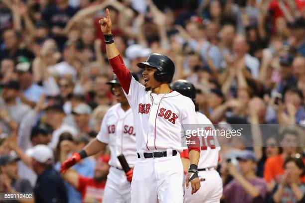 Mookie Betts of the Boston Red Sox celebrates after a tworun RBI double by Hanley Ramirez in the seventh inning against the Houston Astros during...