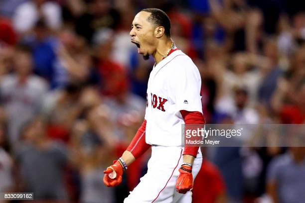 Mookie Betts of the Boston Red Sox celebrates after hitting a go ahead two run double to defeat the St Louis Cardinals 54 at Fenway Park on August 16...