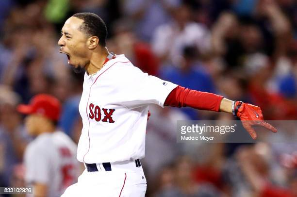 Mookie Betts of the Boston Red Sox celebrates after hitting a walk off two run double to defeat the St Louis Cardinals 54 at Fenway Park on August 16...