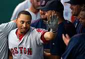 Mookie Betts of the Boston Red Sox celebrates his home run with teammates in the first inning against the Kansas City Royals at Kauffman Stadium on...