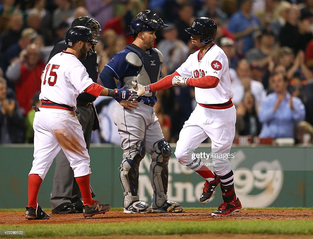 <a gi-track='captionPersonalityLinkClicked' href=/galleries/search?phrase=Mookie+Betts&family=editorial&specificpeople=12732023 ng-click='$event.stopPropagation()'>Mookie Betts</a> #50 of the Boston Red Sox celebrates his home run with <a gi-track='captionPersonalityLinkClicked' href=/galleries/search?phrase=Dustin+Pedroia&family=editorial&specificpeople=836339 ng-click='$event.stopPropagation()'>Dustin Pedroia</a> #15 against Tampa Bay Rays in the sixth inning at Fenway Park May 5, 2015 in Boston, Massachusetts.