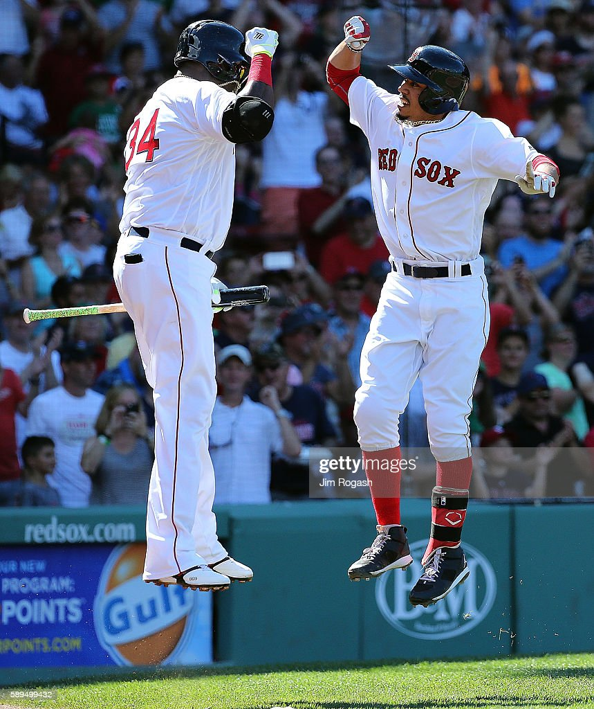 Mookie Betts #50 of the Boston Red Sox celebrates his third home run of the game against the Arizona Diamondbacks with David Ortiz #34 in the fifth inning at Fenway Park on August 14, 2016 in Boston, Massachusetts.