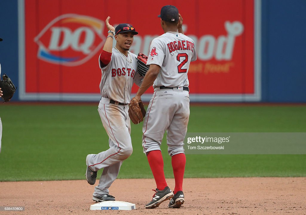 <a gi-track='captionPersonalityLinkClicked' href=/galleries/search?phrase=Mookie+Betts&family=editorial&specificpeople=12732023 ng-click='$event.stopPropagation()'>Mookie Betts</a> #50 of the Boston Red Sox celebrates their victory with <a gi-track='captionPersonalityLinkClicked' href=/galleries/search?phrase=Xander+Bogaerts&family=editorial&specificpeople=9461957 ng-click='$event.stopPropagation()'>Xander Bogaerts</a> #2 during MLB game action against the Toronto Blue Jays on May 29, 2016 at Rogers Centre in Toronto, Ontario, Canada.