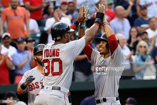 Mookie Betts of the Boston Red Sox celebrates with Chris Young after hitting a three run homer against the Baltimore Orioles in the second inning at...