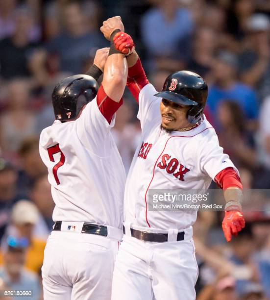 Mookie Betts of the Boston Red Sox celebrates with Christian Vazquez after hitting a home run against the Chicago White Sox in the second inning on...
