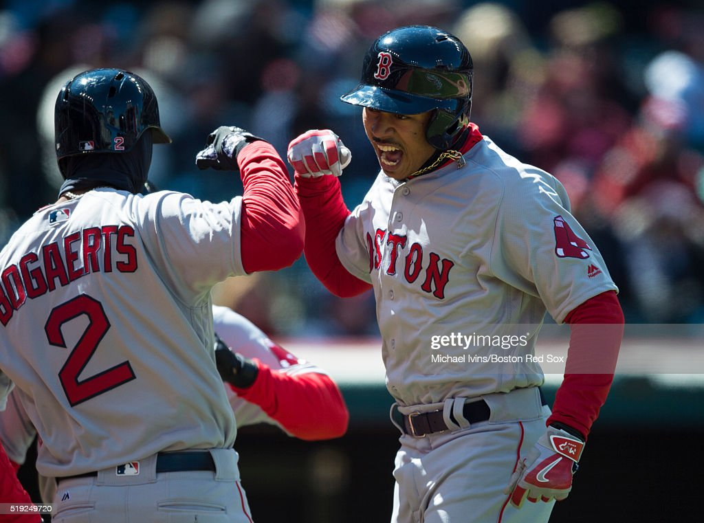 <a gi-track='captionPersonalityLinkClicked' href=/galleries/search?phrase=Mookie+Betts&family=editorial&specificpeople=12732023 ng-click='$event.stopPropagation()'>Mookie Betts</a> #50 of the Boston Red Sox celebrates with <a gi-track='captionPersonalityLinkClicked' href=/galleries/search?phrase=Xander+Bogaerts&family=editorial&specificpeople=9461957 ng-click='$event.stopPropagation()'>Xander Bogaerts</a> #2 after hitting a two-run home run gainst the Cleveland Indians in the third inning on April 5, 2016 at Progressive Field in Cleveland, Ohio.