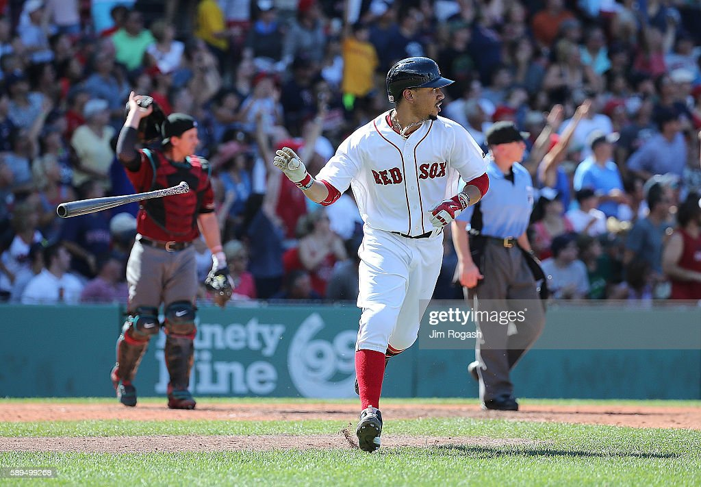 Mookie Betts #50 of the Boston Red Sox connects for his third home run of the game against the Arizona Diamondbacks in the fifth inning at Fenway Park on August 14, 2016 in Boston, Massachusetts.