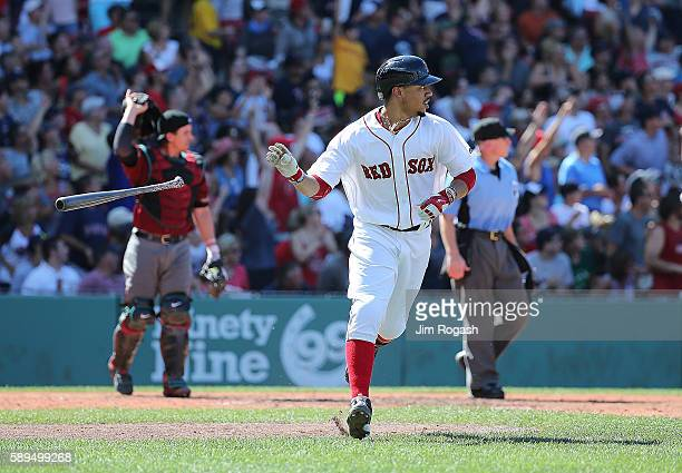 Mookie Betts of the Boston Red Sox connects for his third home run of the game against the Arizona Diamondbacks in the fifth inning at Fenway Park on...