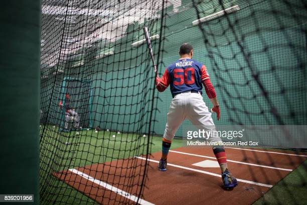 Mookie Betts of the Boston Red Sox dons a nicknamebearing jesery while hitting in the batting cage before a Player's Weekend game against the...