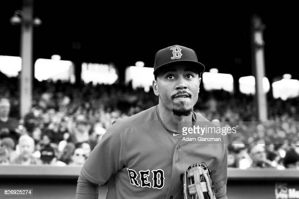 Mookie Betts of the Boston Red Sox enters the field before a game against the Chicago White Sox at Fenway Park on August 4 2017 in Boston...