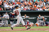 Mookie Betts of the Boston Red Sox follows his three run homer against the Baltimore Orioles in the second inning at Oriole Park at Camden Yards on...