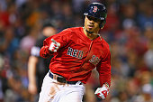Mookie Betts of the Boston Red Sox gestures towards the Red Sox dugout after hitting a single against the Tampa Bay Rays during the seventh inning at...