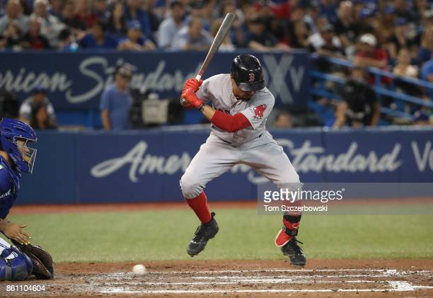Mookie Betts of the Boston Red Sox gets out of the way of an inside pitch in the sixth inning during MLB game action against the Toronto Blue Jays at...