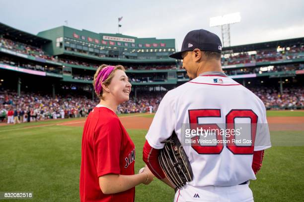 Mookie Betts of the Boston Red Sox greets a Jimmy Fund patient during a Jimmy Fund RadioTelethon pregame ceremony before a game between the Boston...