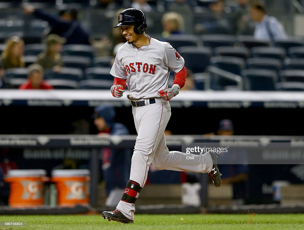 Mookie Betts of the Boston Red Sox heads for home after he hit a two run home run in the eleventh inning against the New York Yankees on September 30...