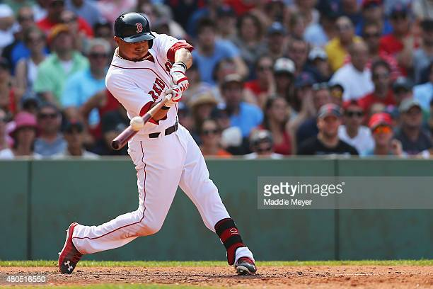 Mookie Betts of the Boston Red Sox hits a fly ball caught by Chris Young of the New York Yankees to end the sixth inning at Fenway Park on July 12...
