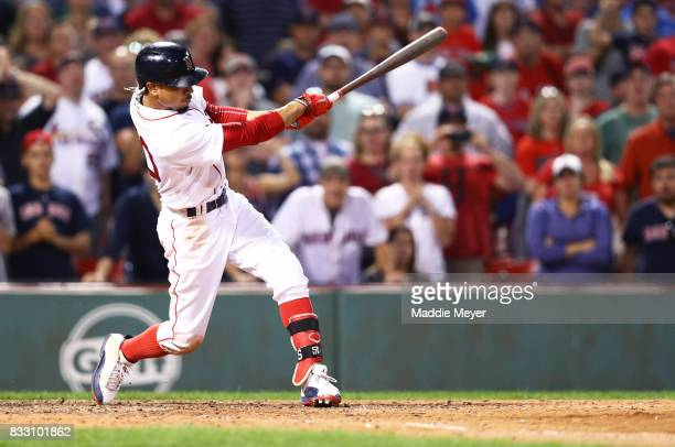 Mookie Betts of the Boston Red Sox hits a go ahead two run double to defeat the St Louis Cardinals 54 at Fenway Park on August 16 2017 in Boston...