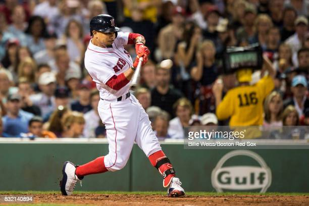 Mookie Betts of the Boston Red Sox hits a single during the fourth inning of a game against the St Louis Cardinals on August 15 2017 at Fenway Park...