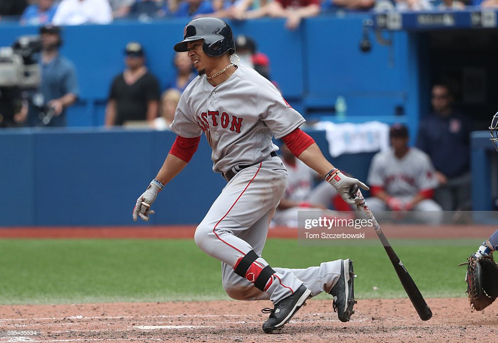 Mookie Betts #50 of the Boston Red Sox hits a single in the ninth inning during MLB game action against the Toronto Blue Jays on May 29, 2016 at Rogers Centre in Toronto, Ontario, Canada.