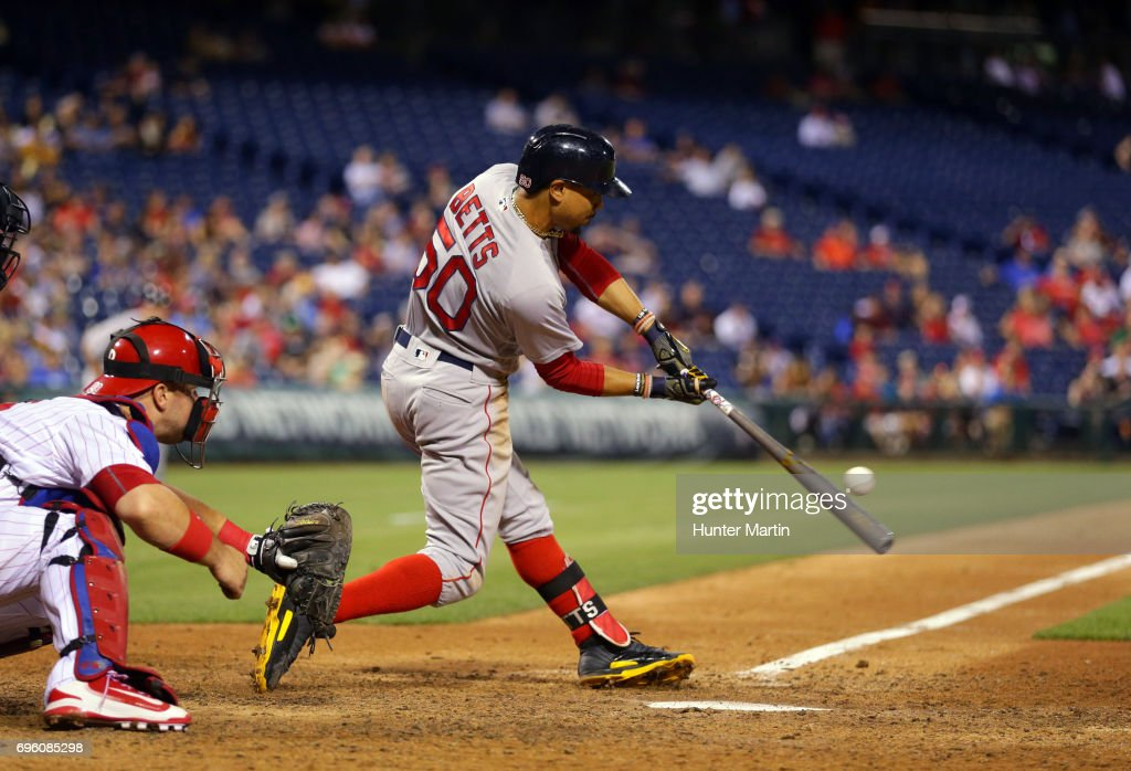 Mookie Betts #50 of the Boston Red Sox hits a solo home run in the ninth inning during a game against the Philadelphia Phillies at Citizens Bank Park on June 14, 2017 in Philadelphia, Pennsylvania. The Red Sox won 7-3. Photo by Hunter Martin/Getty Images)