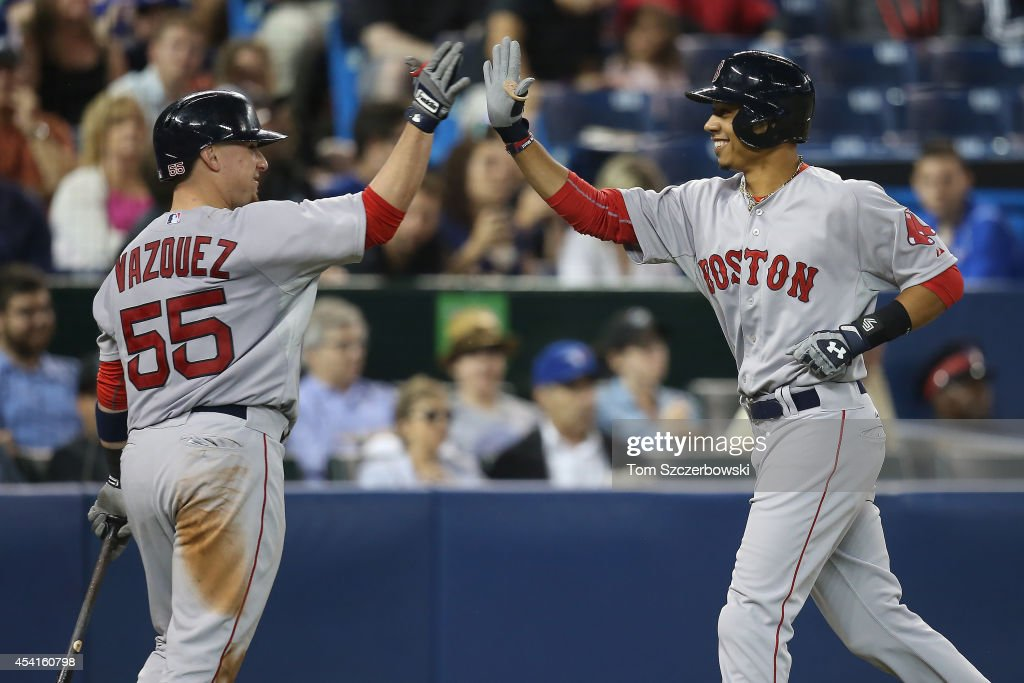 <a gi-track='captionPersonalityLinkClicked' href=/galleries/search?phrase=Mookie+Betts&family=editorial&specificpeople=12732023 ng-click='$event.stopPropagation()'>Mookie Betts</a> #50 of the Boston Red Sox is congratulated by Christian Vazquez #55 after hitting a solo home run in the fifth inning during MLB game action against the Toronto Blue Jays on August 25, 2014 at Rogers Centre in Toronto, Ontario, Canada.