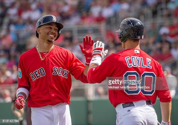 Mookie Betts of the Boston Red Sox is congratulated by Sean Coyle after hitting a threerun home run against the Boston College Eagles in the fifth...