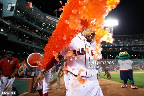 Mookie Betts of the Boston Red Sox is doused in Powerade after hitting a walk off two run double against the St Louis Cardinals at Fenway Park on...
