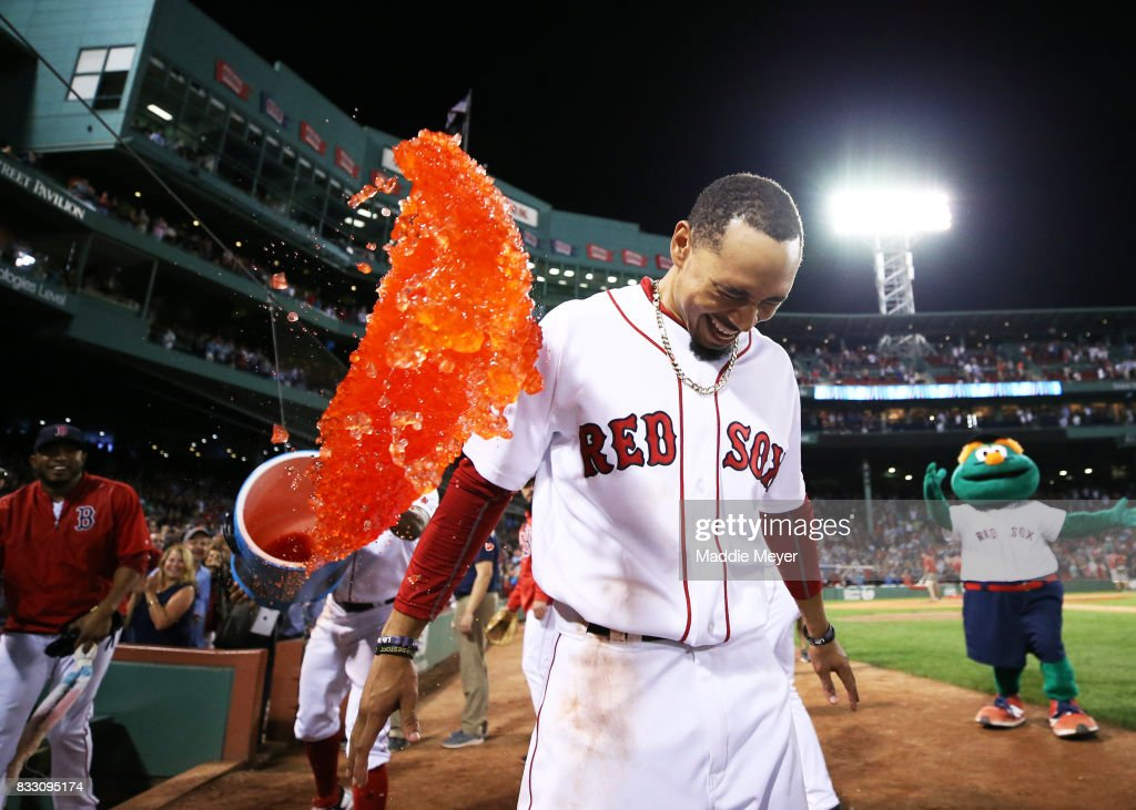 Mookie Betts #50 of the Boston Red Sox is doused in Powerade after hitting a walk off two run double against the St. Louis Cardinals at Fenway Park on August 16, 2017 in Boston, Massachusetts.