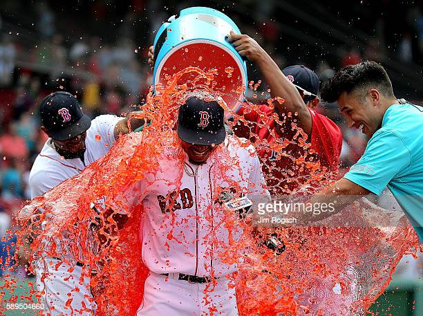 Mookie Betts of the Boston Red Sox is doused with Powerade during an interview after he hit three home runs to help defeat the the Arizona...