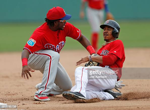 Mookie Betts of the Boston Red Sox is tagged out at third base by Maikel Franco of the Philadelphia Phillies during the fourth inning of a spring...
