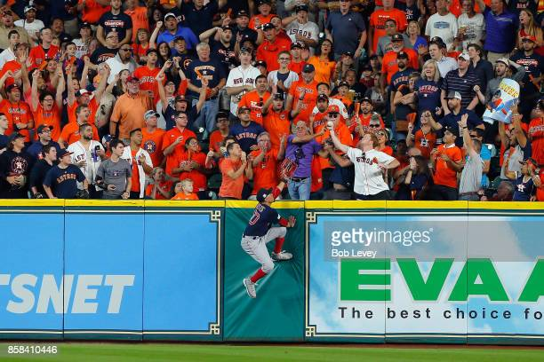 Mookie Betts of the Boston Red Sox is unable to catch a home run ball hit by George Springer of the Houston Astros in the third inning during game...