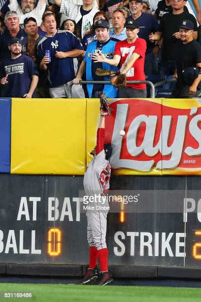 Mookie Betts of the Boston Red Sox is unable to catch a RBI triple off the bat of Austin Romine of the New York Yankees in the fifth inning at Yankee...