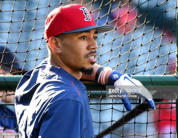 Mookie Betts of the Boston Red Sox leans on the batting cage before the game against the Los Angeles Angels of Anaheim at Angel Stadium of Anaheim on...