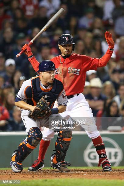 Mookie Betts of the Boston Red Sox looks on as Juan Centeno of the Houston Astros trows to second base in the eighth inning of a game at Fenway Park...