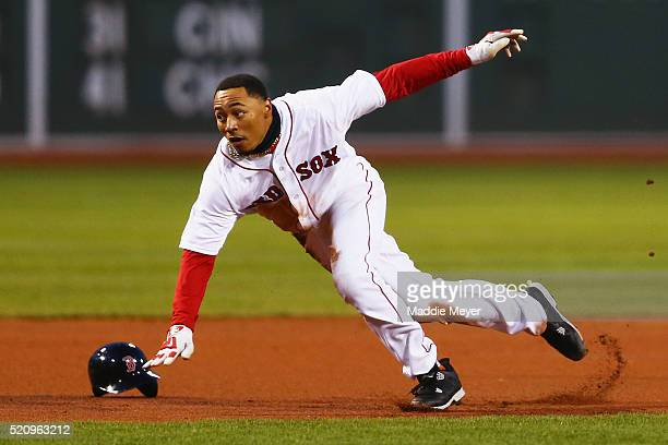 Mookie Betts of the Boston Red Sox loses his helmet running between second and third during the first inning against the Baltimore Orioles at Fenway...