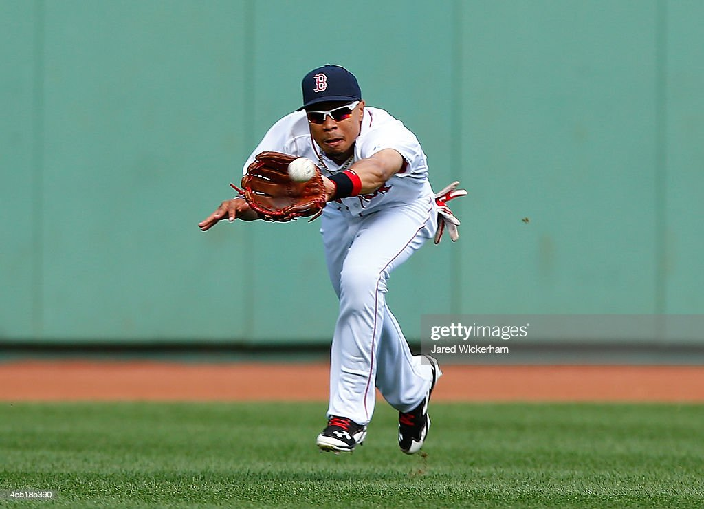<a gi-track='captionPersonalityLinkClicked' href=/galleries/search?phrase=Mookie+Betts&family=editorial&specificpeople=12732023 ng-click='$event.stopPropagation()'>Mookie Betts</a> #50 of the Boston Red Sox makes a catch in center field against the Baltimore Orioles during the game at Fenway Park on September 10, 2014 in Boston, Massachusetts.