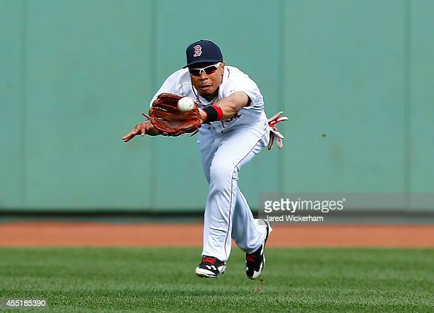 Mookie Betts of the Boston Red Sox makes a catch in center field against the Baltimore Orioles during the game at Fenway Park on September 10 2014 in...