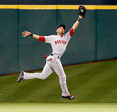 Mookie Betts of the Boston Red Sox makes a running catch on a fly ball by Carlos Correa of the Houston Astros in the first inning at Minute Maid Park...