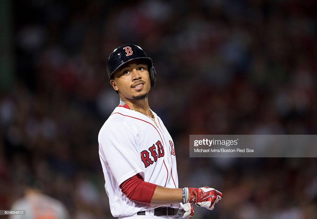Mookie Betts #50 of the Boston Red Sox reacts after a fly out against the Baltimore Orioles in the seventh inning on September 13, 2016 at Fenway Park in Boston, Massachusetts.