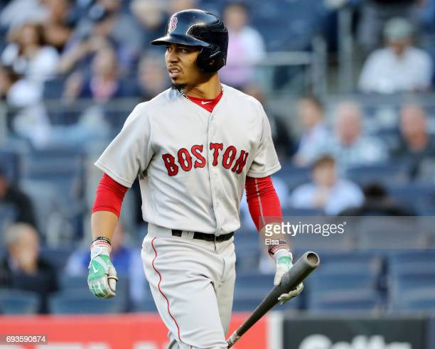 Mookie Betts of the Boston Red Sox reacts after he struck out in the first inning against the New York Yankees on June 7 2017 at Yankee Stadium in...