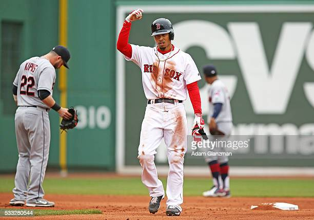 Mookie Betts of the Boston Red Sox reacts after hitting a double in the third inning during the game against the Cleveland Indians at Fenway Park on...