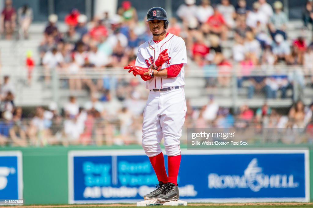 Mookie Betts #50 of the Boston Red Sox reacts after hitting a double during the fifth inning of a Spring Training game against the Atlanta Braves on March 5, 2017 at Fenway South in Fort Myers, Florida .