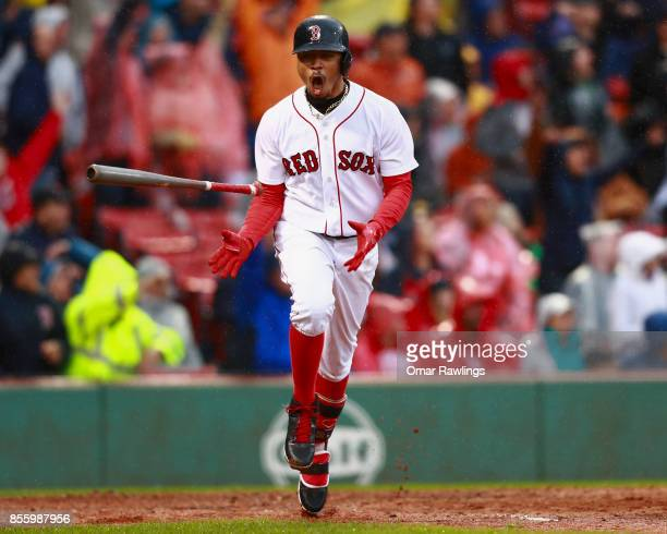 Mookie Betts of the Boston Red Sox reacts after hitting a single homer in the bottom of the seventh inning during the game against the Houston Astros...