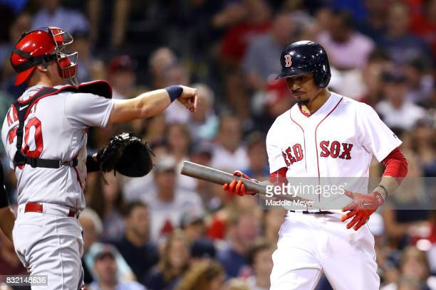Mookie Betts of the Boston Red Sox reacts after striking out against the St Louis Cardinals during the seventh inning at Fenway Park on August 15...