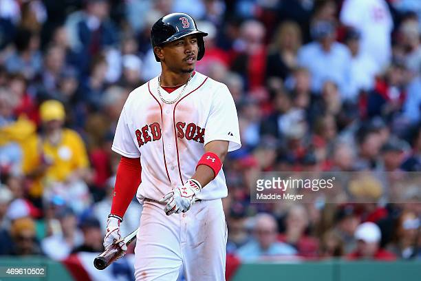 Mookie Betts of the Boston Red Sox reacts after striking out during the seventh inning at Fenway Park on April 13 2015 in Boston Massachusetts