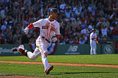 Mookie Betts of the Boston Red Sox rounds first after hitting a home run against the Washington Nationals during the second inning at Fenway Park on...