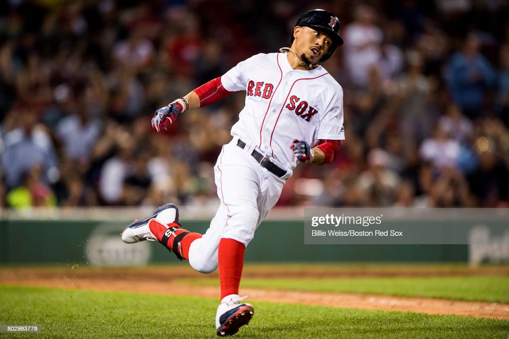 Mookie Betts #50 of the Boston Red Sox rounds first base after hitting a double during the ninth inning of a game against the Minnesota Twins on June 28, 2017 at Fenway Park in Boston, Massachusetts.